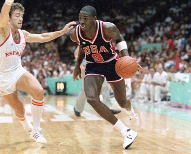 f690450adb516 Michael Jordan's 1984 Olympic sneakers are back up for bids. On the auction  block in 2015, the pair of white and navy blue Converse Fastbreak Mid, game- worn ...